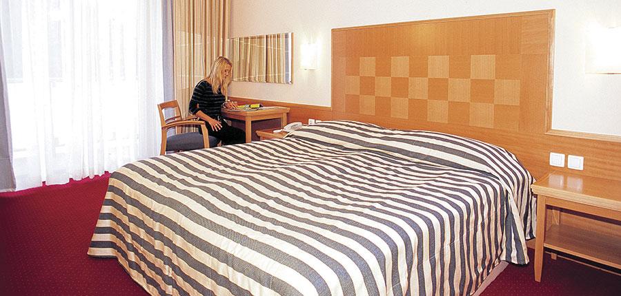 Ramada Hotel & Suites, Kranjska Gora, Slovenia - Standard bedroom.jpg
